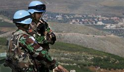 Indonesian U.N peacekeepers patrol the Lebanese side of the Lebanese-Israeli border in the southern village of Kfar Kila, Lebanon, Tuesday May 7, 2013. Four U.N. peacekeepers were seized by armed gunmen on Tuesday while they were patrolling in the demilitarized zone separating Syria from the Israeli-occupied sections of Golan Heights. (Associated Press)