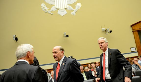 Sen. Ron Johnson (R-Wis.), right, the senator who former Secretary of State Hillary Clinton yelled at during a senate hearing on the attacks in Benghazi, and Rep. Louie Gohmert (R-Texas), center, arrive before a House Oversight and Government Reform Committee hearing on the September 11, 2012 attack in Benghazi, Libya on Capitol Hill, Washington, D.C., Wednesday, May 8, 2013. (Andrew Harnik/The Washington Times)