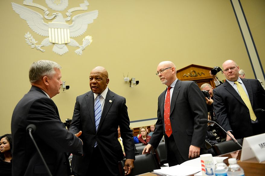 Vice Chairman Elijah Cummings (D-Md.), second from left, greets Acting Deputy Assistant Secretary for Counterterrorism Mark Thompson, left, before he  testifies before a House Oversight and Government Reform Committee hearing on the September 11, 2012 attack in Benghazi, Libya on Capitol Hill, Washington, D.C., Wednesday, May 8, 2013. Also pictured is Diplomatic Security Officer and former Regional Security Officer in Libya Eric Nordstrom, right, and former Deputy Chief of Mission/ChargÈ díAffairs in Libya Gregory Hicks, second from right. (Andrew Harnik/The Washington Times)