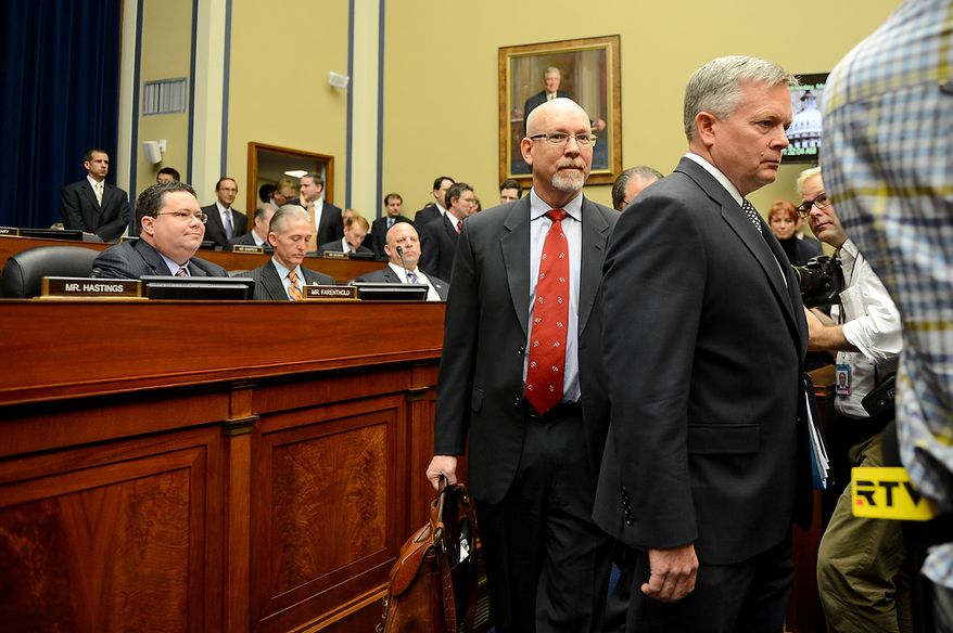 Foreign Service Officer and former Deputy Chief of Mission/ChargÈ díAffairs in Libya Gregory Hicks, center, and State Department officials Acting Deputy Assistant Secretary for Counterterrorism Mark Thompson, right, arrive to testify before a House Oversight and Government Reform Committee hearing on the September 11, 2012 attack in Benghazi, Libya on Capitol Hill, Washington, D.C., Wednesday, May 8, 2013. (Andrew Harnik/The Washington Times)