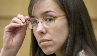 **FILE** Jodi Arias sits in the courtroom during her trial at Maricopa County Superior Court in Phoenix on May 1, 2013. Arias is charged with first-degree murder in the June 2008 death of her boyfriend Travis Alexander, a motivational speaker and salesman, at his suburban Phoenix home. (Associated Press)