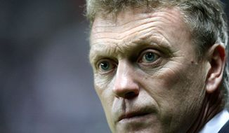 FILE - This is a Wednesday, Jan. 2, 2013 file photo of Everton's manager David Moyes as he looks on ahead of their English Premier League soccer match against Newcastle United at St James' Park, Newcastle, England. Everton manager David Moyes and Real Madrid coach Jose Mourinho are the two clear favorites, to succeed Alex Ferguson who will retire as Manchester United's manager at the end of the current season . The announcement of Ferguson's retirement was made on Wednesday May 8, 2013. (AP Photo/Scott Heppell, File)