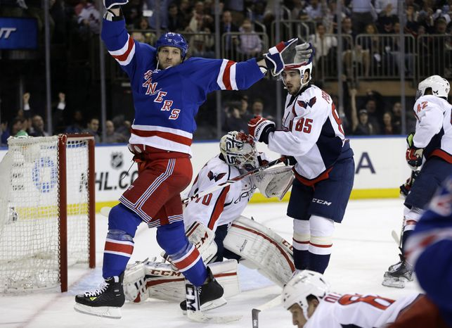 New York Rangers right wing Ryane Clowe (29) celebrates a goal scored by left wing Carl Hagelin in the second period of Game 4 of their first-round NHL hockey Stanley Cup playoff series against the Washington Capitals in New York, Wednesday, May 8, 2013. (AP Photo