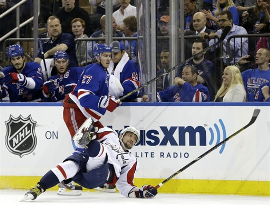 Washington Capitals left wing Alex Ovechkin (8) of Russia is upended after he was checked by New York Rangers defenseman Ryan McDonagh (27) in the second period of Game 3 of their first-round NHL hockey Stanley Cup playoff series in New York, Monday, May 6, 2013. (AP Photo/kathy willens)