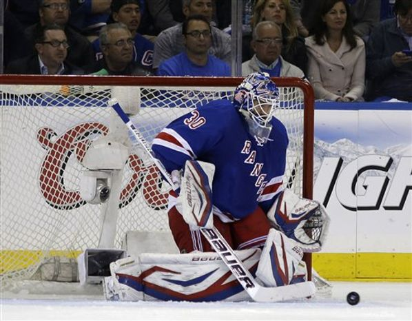 New York Rangers goalie Henrik Lundqvist (30) of Sweden makes in the second period of Game 3 of their first-round NHL hockey Stanley Cup playoff series in New York, Monday, May 6, 2013. (AP Photo/kathy willens)