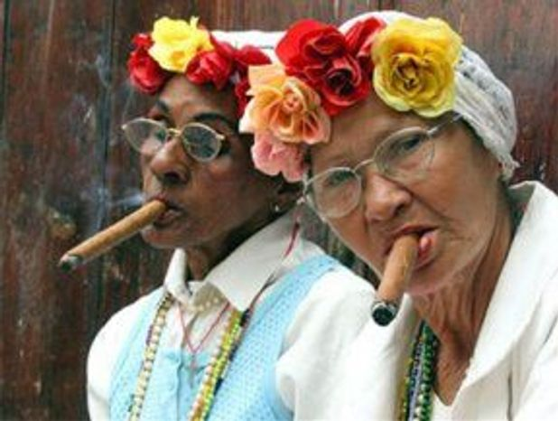 ** FILE ** Cuban ladies smoke the country's