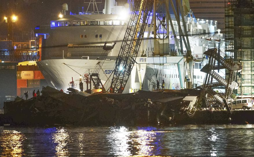 Rescuers search what is left of the control tower of the port of Genoa, northern Italy, after it collapsed when a cargo ship slammed into it killing at least three people, Tuesday, May 7, 2013. (AP Photo/Francesco Pecoraro)