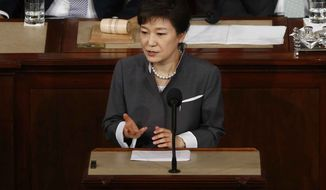 ** FILE ** South Korean President Park Geun-hye addresses a joint session of Congress on Capitol Hill in Washington on May 8, 2013. (Associated Press)