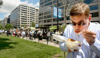 Jason Bernstein and Courtney Smothers eat their lunches bought from food trucks lining the sidewalks along Farragut Square Park at lunchtime Thursday. (Andrew Harnik/The Washington Times)