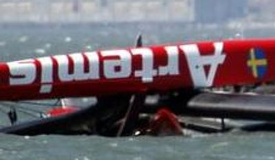 The overturned Artemis Racing AC72 catamaran, an America's Cup entry from Sweden, is towed past Treasure Island after the boat capsized during training in San Francisco Bay on Thursday, May 9, 2013, in San Francisco, Calif. (AP Photo/San Jose Mercury News, Karl Mondon)