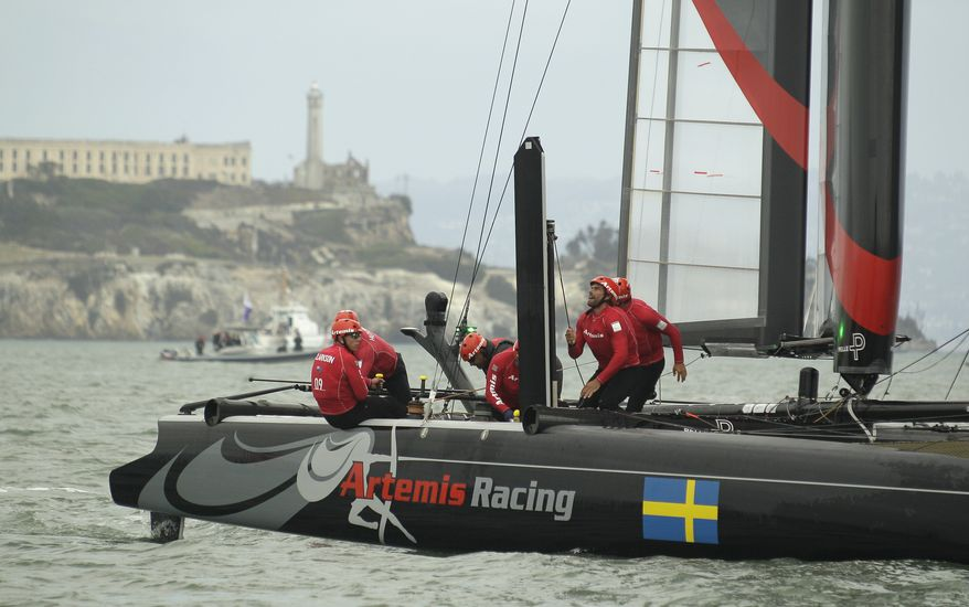 **FILE** The crew of Artemis Racing White of Sweden, races against Team Korea with Alcatraz Island in the background during their quarterfinal match race of the America's Cup World Series sailing event in San Francisco, Thursday, Oct. 4, 2012. Racing of the AC45 boats continues though Sunday on San Francisco Bay. Artemis Racing White won their race. (AP Photo/Eric Risberg)