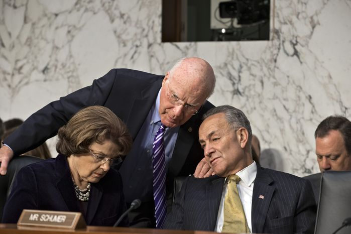 **FILE** Senate Judiciary Committee Chairman Patrick Leahy (center), Vermont Democrat, speaks with committee members and Democratic Sens. Charles Schumer (right) of New York and Dianne Feinstein of California on Capitol Hill in Washingt