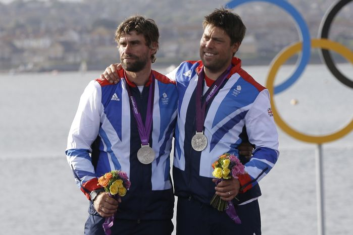 **FILE** Great Britain's star class crew Iain Percy, right, and Andrew Simpson celebrate their silver medal at the London 2012 Summer Olympics, Sunday, Aug. 5, 2012, in Weymouth and Portland, England. (AP Photo/Bernat Armangue)