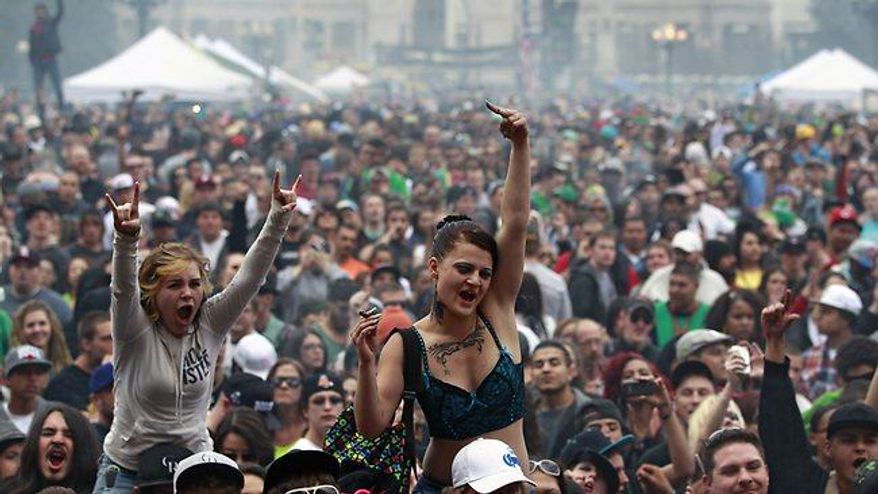 Thousands enjoy a marijuana celebration in Denver, Colo. on April 20, 2013. (Associated Press)