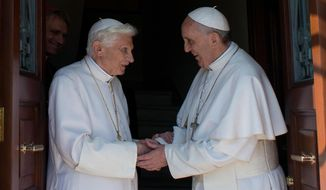 Pope Emeritus Benedict XVI (left) is welcomed by Pope Francis as he returns to the Vatican from the pontifical summer residence of Castel Gandolfo, southeast of Rome, on Thursday, May 2, 2013. (AP Photo/Osservatore Romano)
