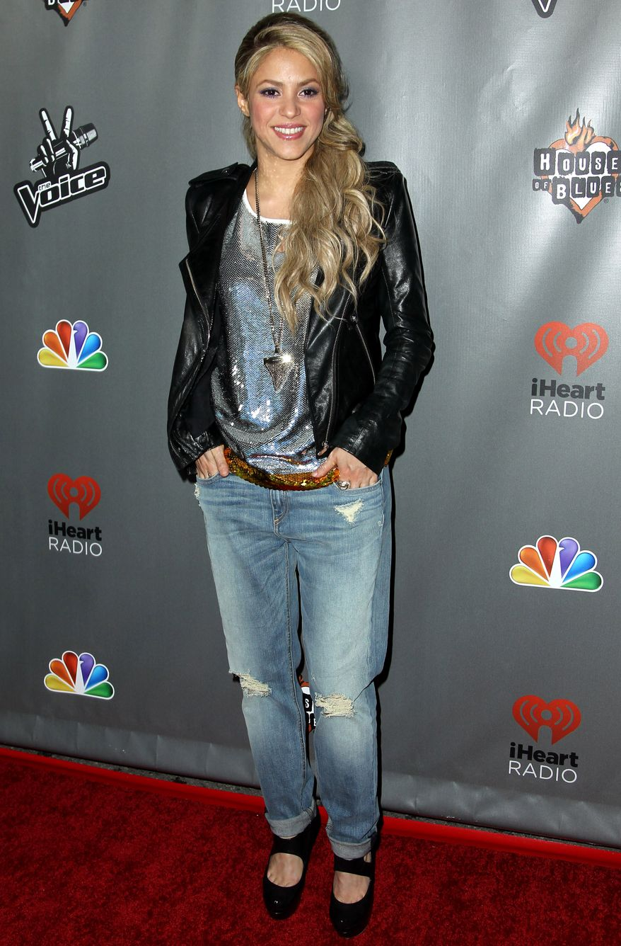 "Colombian singer Shakira arrives at a red-carpet event marking the fourth season of ""The Voice"" at the House of Blues on Wednesday, May 8, 2013, in West Hollywood, Calif. (Matt Sayles/Invision/AP)"
