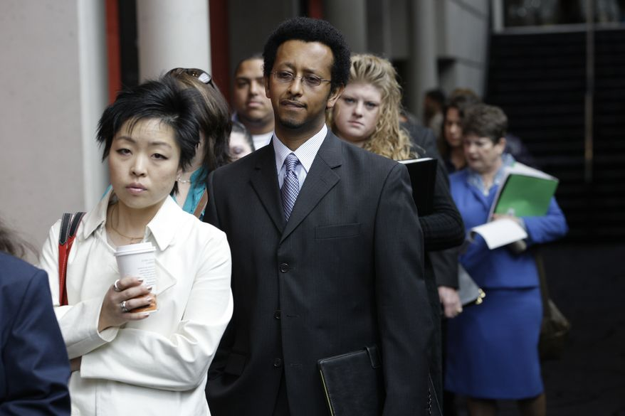 ** FILE ** Job seekers wait in line to attend a job fair in Tacoma, Wash., April 27, 2010. (AP Photo/Ted S. Warren)