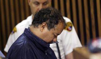 Ariel Castro appears in Cleveland Municipal Court on Thursday, May 9, 2013, in Cleveland. He was charged with four counts of kidnapping and three counts of rape. (AP Photo/Tony Dejak)