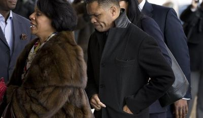 ** FILE ** Former Illinois Rep. Jesse Jackson Jr. and his legal team arrives at the E. Barrett Prettyman Federal Courthouse in Washington on Feb. 20, 2013. (Associated Press)