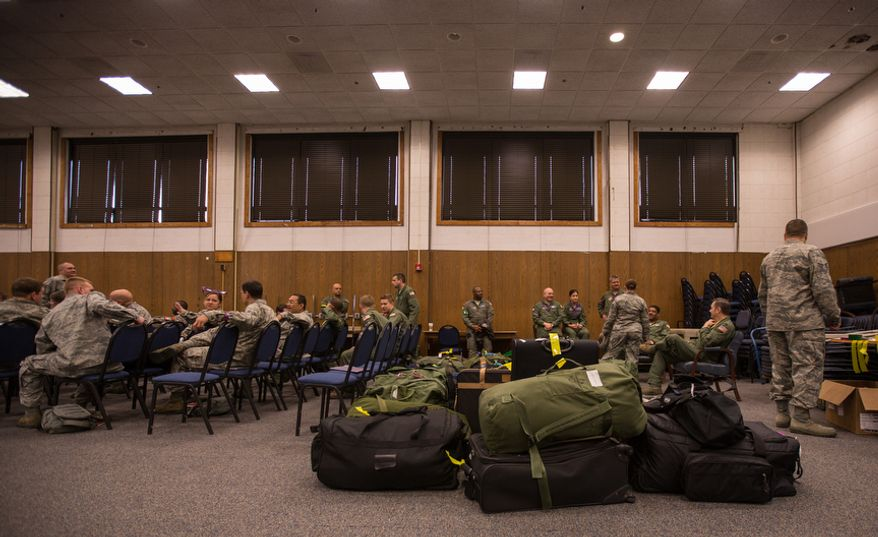 Reservists attached to the 459th Air Refueling Wing pack their bags on May 10, 2013, at Joint Base Andrews, Md., and discuss their upcoming deployment that will take place next week in support of Operation Enduring Freedom. The unit will deploy to the 379th Air Expeditionary Wing in an undisclosed location in southwest Asia and will provide aerial refueling in support of the operation. (Andrew S. Geraci/The Washington Times)