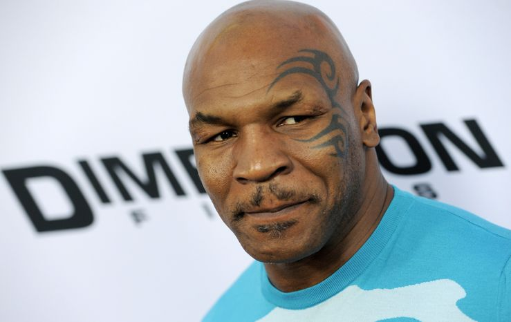 "**FILE** Mike Tyson attends the Los Angeles premiere of ""Scary Movie V"" in Los Angeles on April 11, 2013. (Chris Pizzello/Invision/Associated Press)"
