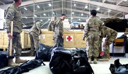 NATO service members haul in supplies that will be used at the first established facility aboard Camp Shorabak intended specifically for surgical care. The unit will allow Afghans to perform ambulatory care independent of coalition support. (Defense Department)