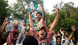 Pakistan Muslim League party supporters celebrate their party's victory in the parliamentary election in Lahore, Pakistan, on Sunday. Nawaz Sharif is the likely next prime minister. (Associated Press)