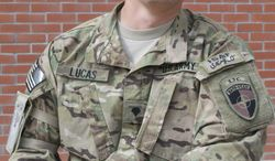 Spc. Jason Lucas, 22, misses his wife, Emily, and his two dogs back at home in Williamsburg, Va. He plans to send his mother flowers this Mother's Day, which he said is harder for her, with two of her sons deployed. (Kristina Wong/The Washington Times)