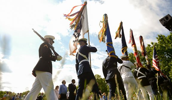 Members of the Joint Armed Forces Color Guard perform the presentation of the colors at a Mother's Day ceremony to honor four American servicemen who have been added to the wall of the Vietnam Veterans Memorial, Washington, D.C., Sunday, May 12, 2013. (Andrew Harnik/The Washington Times)