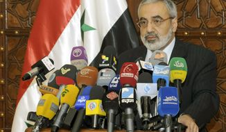 ** FILE ** Syrian Information Minister Omran al-Zoubi speaks during a press conference in Damascus, Syria, on Sunday, May. 5, 2013. (AP Photo/SANA)