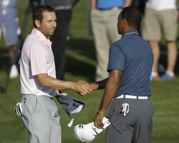 Sergio Garcia (left) of Spain shakes hands with Tiger Woods at the conclusion of the third round of The Players championship golf tournament at TPC Sawgrass on Sunday, May 12, 2013, in Ponte Vedra Beach, Fla. (AP Photo/Gerald Herbert)