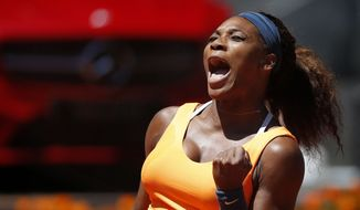 Serena Williams from the U.S. celebrates a point on her way to win the final of the Madrid Open tennis tournament against Maria Sharapova from Russia, in Madrid Sunday, May 12, 2013. (AP Photo/Daniel Ochoa de Olza)