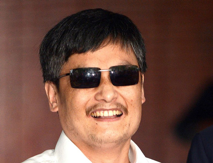 "Chinese authorities are believed to be inflicting ""harassment and abuse"" on family members to Chen Guangcheng, a blind Chinese activist living in the United States. (Associated Press)"