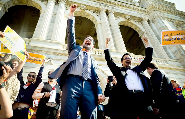 State Sen. D. Scott Dibble (left), sponsor of the gay marriage bill in the Minnesota Senate, and his partner Richard Leyva greet a crowd at the State Capitol. Gov. Mark D