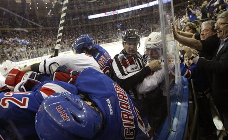 The Washington Captials and the New York Rangers brawl after the buzzer at the end of the third period of Game 6 of their NHL Stanley Cup hockey playoff series in New York, Sunday, May 12, 2013. The Rangers evened the series at 3-3 with a 1-0 shutout, forcing a Game 7 in Washington Monday. (AP Photo/Kathy Willens)