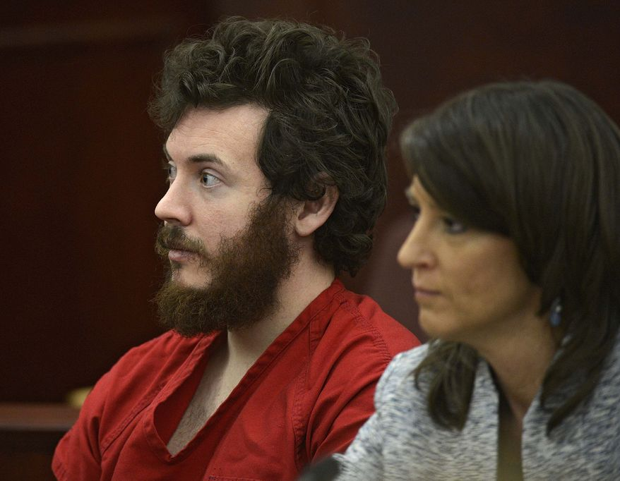 ** FILE ** In this March 12, 2013, file photo, James Holmes, left, and defense attorney Tamara Brady appear in district court in Centennial, Colo. for his arraignment. (AP Photo/The Denver Post, RJ Sangosti, Pool, File)