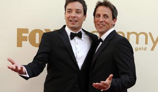 "** FILE ** This Sept. 18, 2011, file photo shows Jimmy Fallon, left, and Seth Meyers at the 63rd Primetime Emmy Awards in Los Angeles. Meyers is moving from his ""Weekend Update"" desk to his own late night show on NBC. (AP Photo/Chris Pizzello, file)"