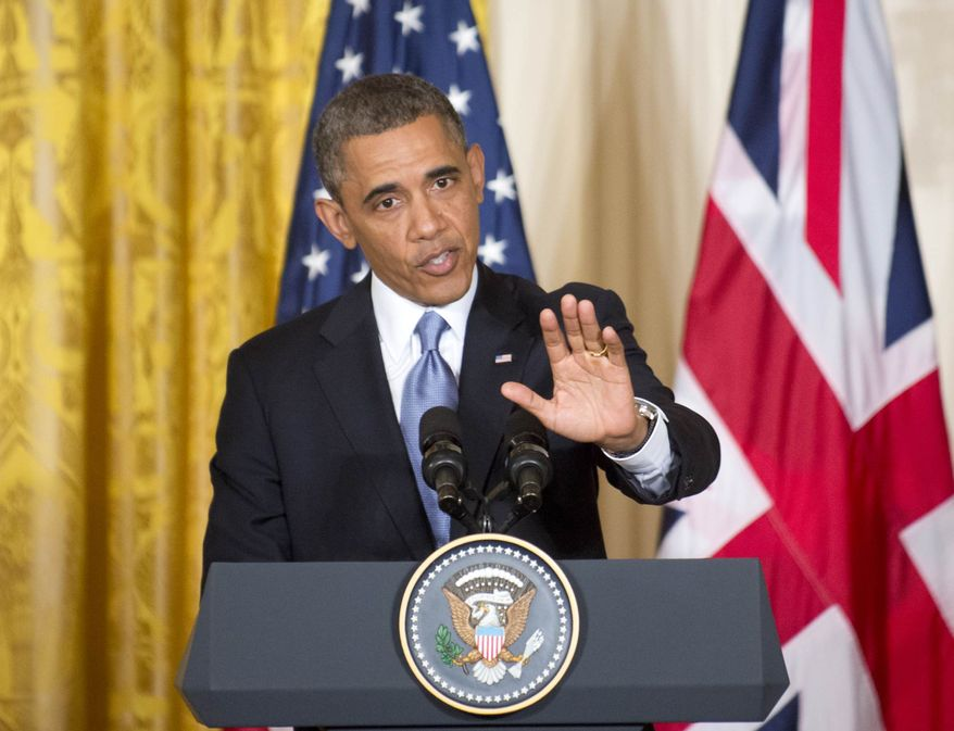 President Obama gestures during a joint news conference with British Prime Minister David Cameron on Monday, May 13, 2013, in the East Room of the White House in Washington, where they talked about subjects ranging from Syria's civil war to preparations for a coming summit in Northern Ireland. (AP Photo/J. Scott Applewhite)