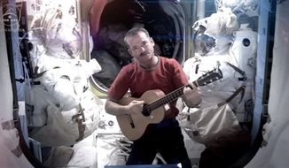 Astronaut Chris Hadfield recording the first music video from space Sunday May 12, 2013. The song was his cover version of David Bowie's Space Oddity. (AP Photo/NASA, Chris Hadfield)