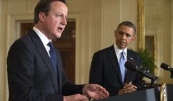 British Prime Minister David Cameron speaks during a joint news conference with President Obama on May 13, 2013, in the East Room of the White House. (Associated Press)