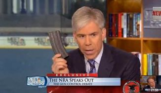 "NBC News' David Gregory holds up 30-round magazine on ""Meet the Press"" in Washington, D.C."