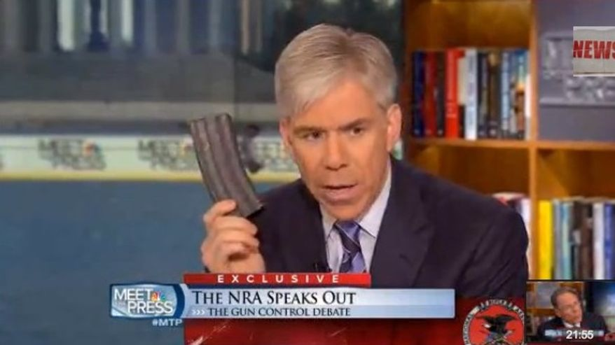 """NBC News' David Gregory holds up 30-round magazine on """"Meet the Press"""" in Washington, D.C."""