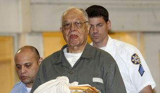 A movie is being planned about abortionist Kermit Gosnell, shown here being escorted to police custody after his May 2013 murder convictions for killing newborn babies. The movie producers are seeking additional funds through Indiegogo. (Associated Press/Philadelphia Daily News)