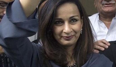 **FILE** Ruling Pakistan People's Party leader and Information Minister Sherry Rehman (left) makes victory signs as she and her colleagues Farooq Naik (right) and Asfandyar Wali (center back) leaves from main office of election commission after filing nomination papers of Asif Ali Zardari for presidential election on Aug. 26, 2008, in Islamabad, Pakistan. (Associated Press)