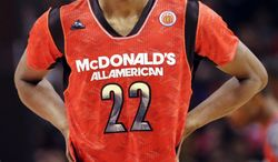 **FILE** McDonald's East All-American's Andrew Wiggins looks up during the first half of the McDonald's All-American boys basketball game in Chicago, Wednesday, April 3, 2013. (AP Photo/Nam Y. Huh)