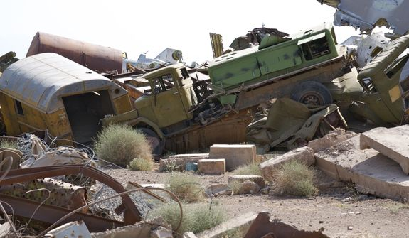 """Known as the """"Shindand boneyard,"""" scraps of Soviet aircraft from the 1980s litter the landscape at Shindand Air Base, an Afghan military base in the westernmost province of Herat. (Kristina Wong/The Washington Times)"""