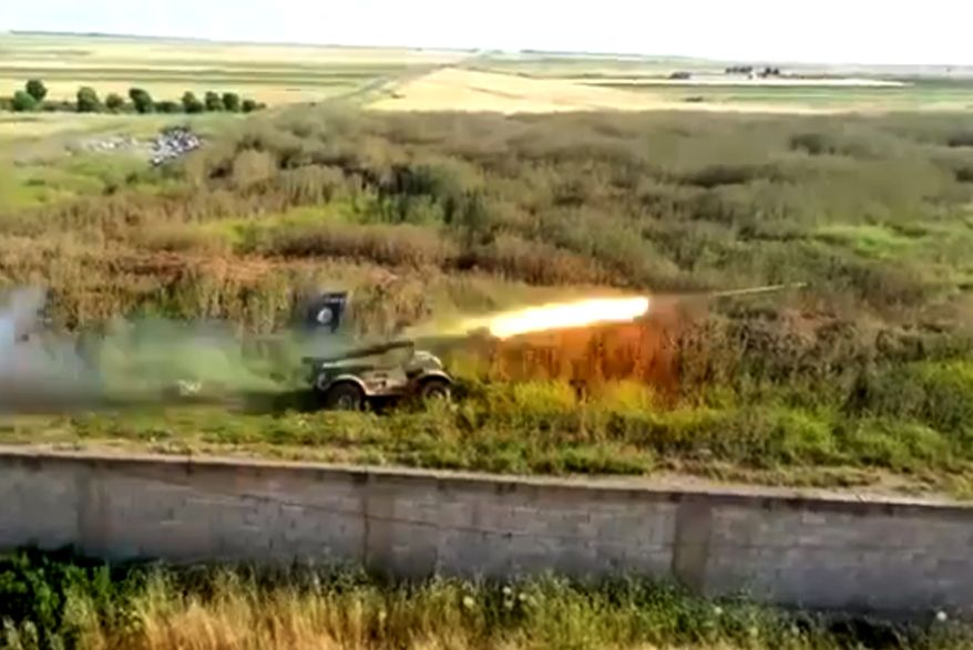 This image taken from video obtained from Ugarit News, which has been authenticated based on its contents and other AP reporting, shows a rocket fired by Syrian rebels at Mannagh air base in the Aleppo province of Syria on May 13, 2013. (Associated Press/Ugarit News via AP video)