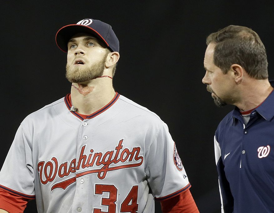 Washington Nationals outfielder Bryce Harper left Monday night's game in the fifth inning after a gruesome collision with the right field scoreboard at Dodger Stadium. (Associated Press photo)