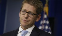 White House spokesman Jay Carney takes questions during his daily news briefing at the White House in Washington on May, 14, 2013. Carney touched on various topics including the Justice Department's secretly obtaining two months of telephone records of reporters and editors for the Associated Press and IRS. (Associated Press)