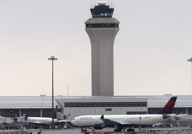 ** FILE ** Jets sit on the apron at Detroit Metropolitan Wayne County Airport in Romulus, Mich., on Dec. 26, 2009. (AP Photo/Carlos Osorio)